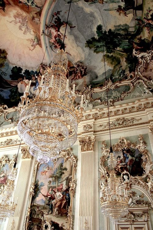 A beautiful baroque style venue with chandelier and painted ceiling