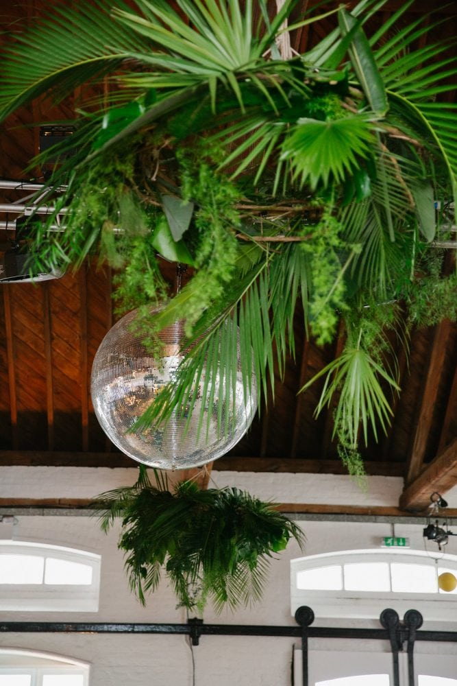 Jungle mirror ball at a Jazz in the Jungle wedding. Wedding by Knot & Pop - UK wedding planners and event designers