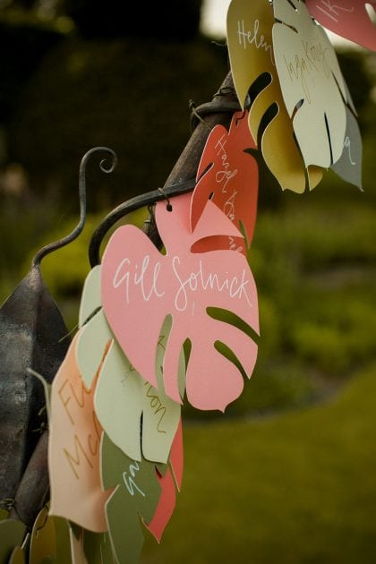 A tropical table plan at a UK countryside wedding in Norfolk by UK wedding planners Knot & Pop