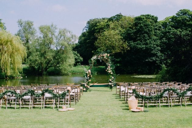 Tropical wedding ceremony in Norfolk at Narborough Hall Gardens.