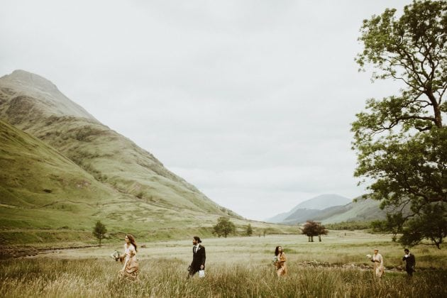 Scottish wedding procession in the mountains