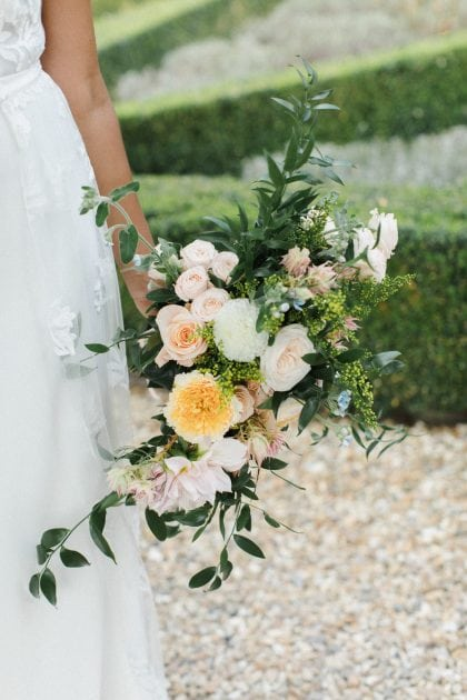 Yellow, pale pink and white wedding bouquet at a Chateau wedding in Normandy France