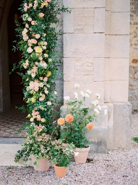 Potted plants church entrance at a wedding in France
