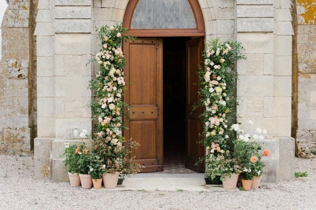 Church flower and potted plant orangery entrance at a wedding in Normandy France