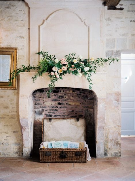 Mantlepiece flowers and foliage at a wedding in Normandy France