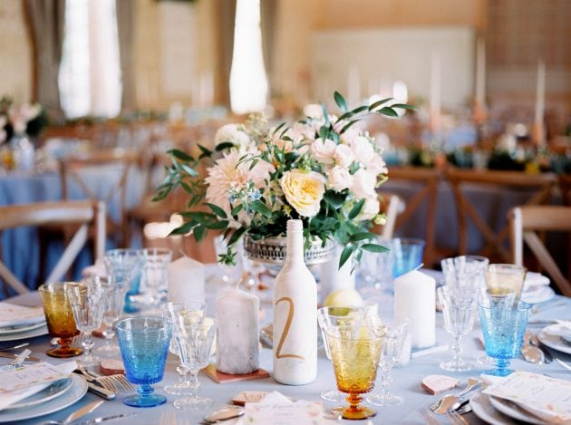 Coloured glassware at a wedding in Normandy France by wedding stylists Knot & Pop