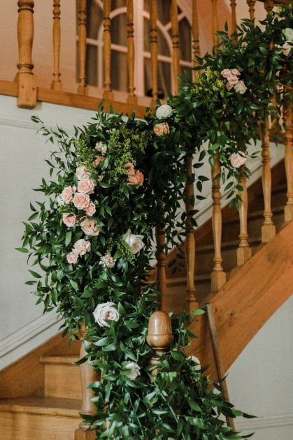 Floral staircase at a wedding in Normandy France by wedding stylists Knot & Pop