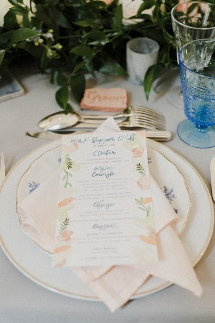 Terracotte pot place names at a wedding in Normandy France by wedding stylists Knot & Pop