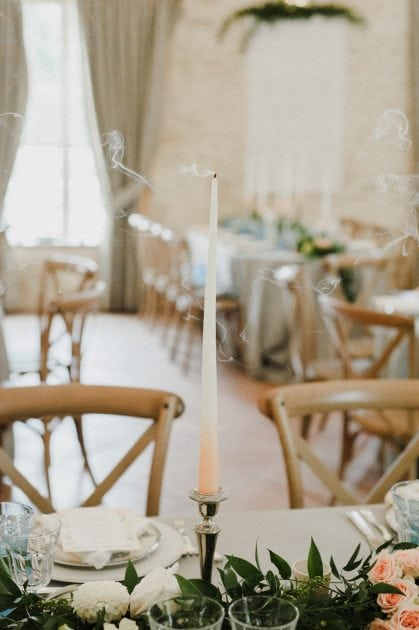 Peach dip taper candle at a wedding in Normandy France by wedding stylists Knot & Pop