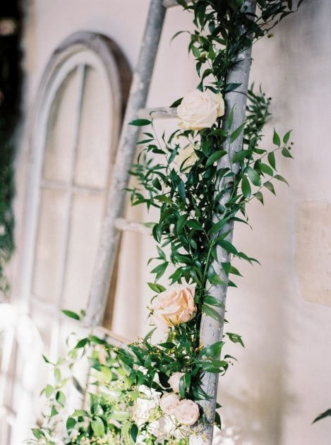 An floral ladder with concept and styling by Knot & Pop and photography by Bubble Rock. Wedding in Normandy France at a Chateau with an Orangery and Walled Garden.