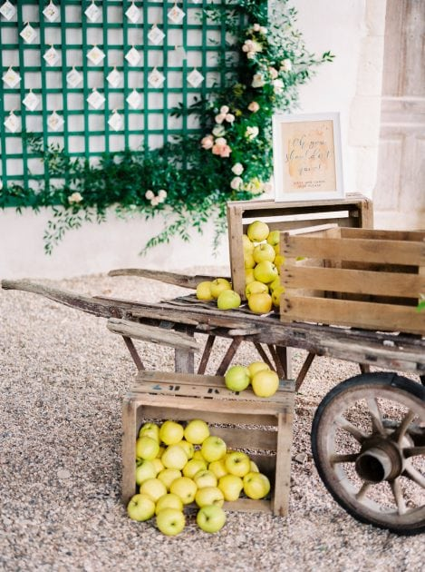 An apple cart with concept and styling by Knot & Pop and photography by Bubble Rock. Wedding in Normandy France at a Chateau with an Orangery and Walled Garden.