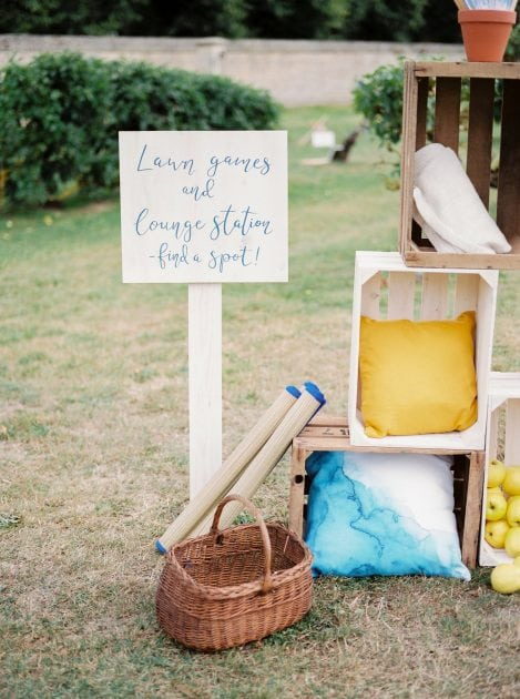 Blanket and Cushion station with watercolour cushions at a wedding in Normandy France by wedding stylists Knot & Pop