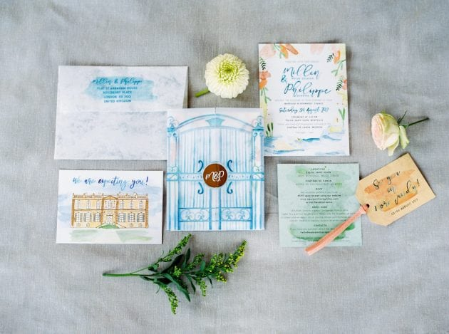 Blue and peach watercolour illustrated chateau wedding invitation