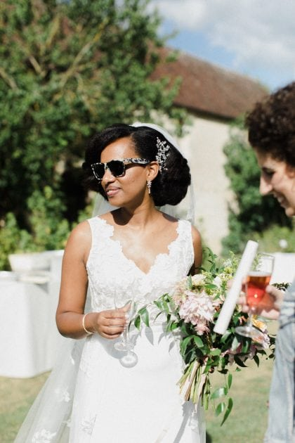 Cool modern bride with sunglasses at their outdoor drinks reception in Normandy France