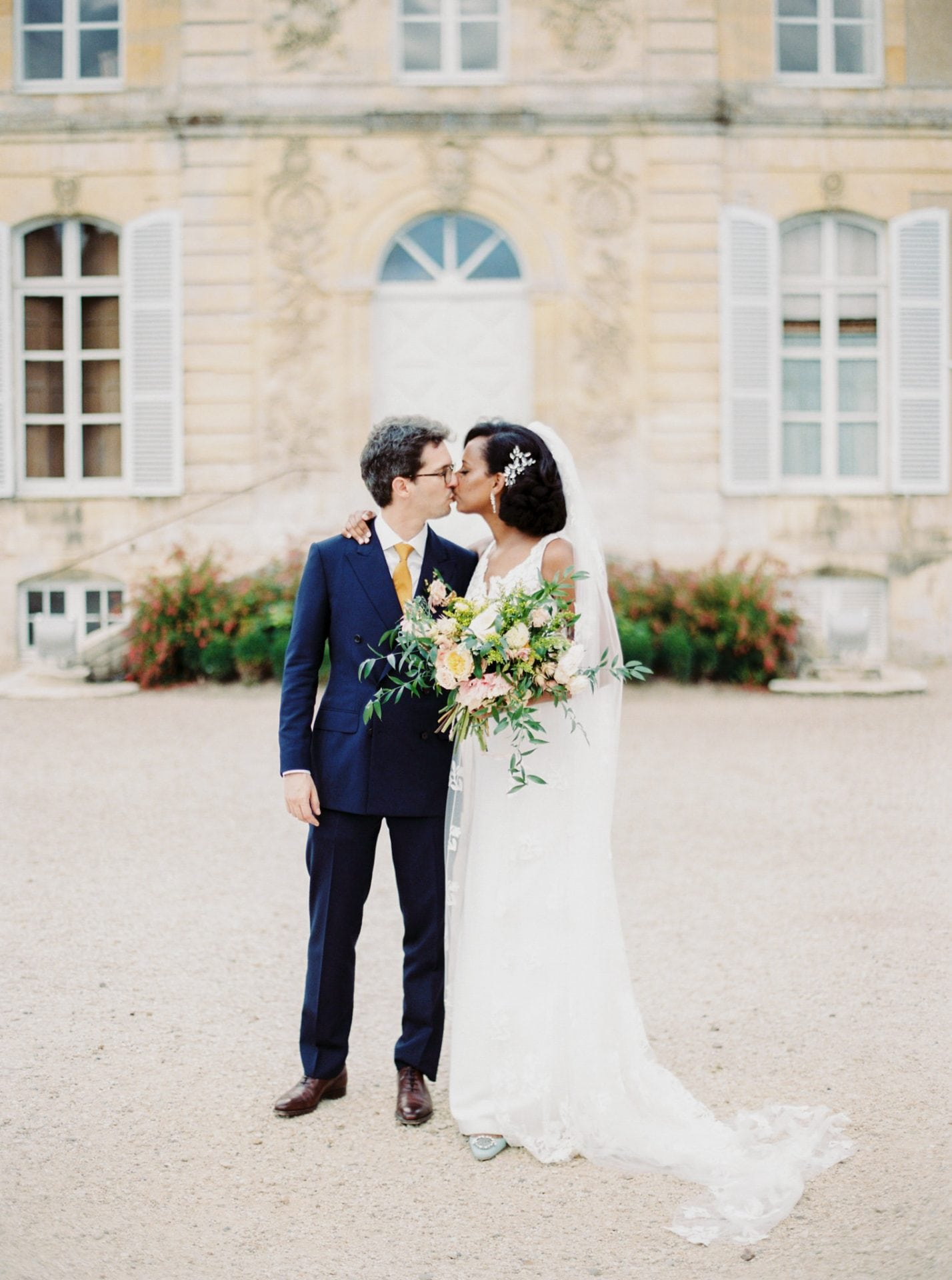 Bride and groom chateau portrait at a wedding in France
