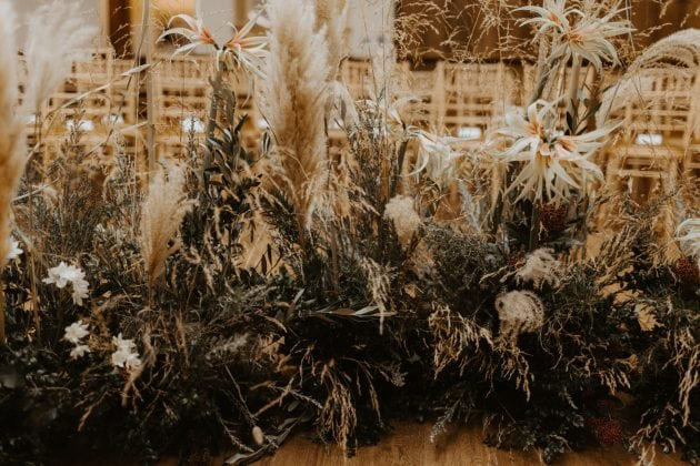Pampas grass and foliage at a Castle Winter Wedding by wedding planners and event stylists, Knot & Pop. Photography by The Hendrys.