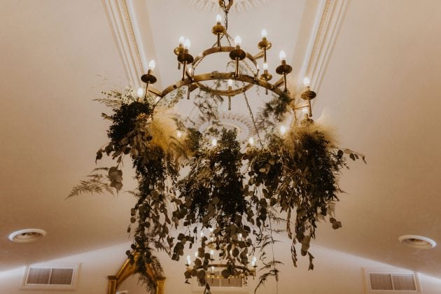 Foliage chandelier at a Castle Winter Wedding by wedding planners and event stylists, Knot & Pop. Photography by The Hendrys.