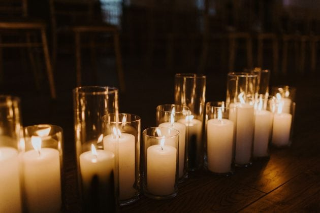 Pillar candles at a Castle Winter Wedding by wedding planners and event stylists, Knot & Pop. Photography by The Hendrys.