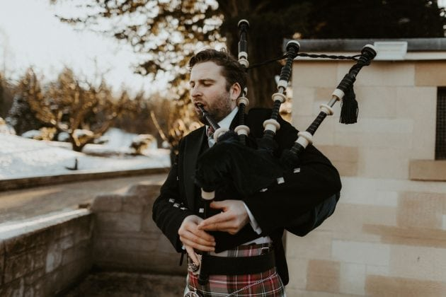 Bag-piper at a Castle Winter Wedding by wedding planners and event stylists, Knot & Pop. Photography by The Hendrys.