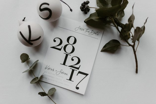Black and white typography Save the Date at a Castle Winter Wedding by wedding planners and event stylists, Knot & Pop. Photography by The Hendrys.