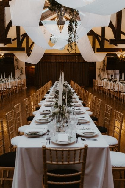 Monochrome table setting at a Castle Winter Wedding by wedding planners and event stylists, Knot & Pop. Photography by The Hendrys.