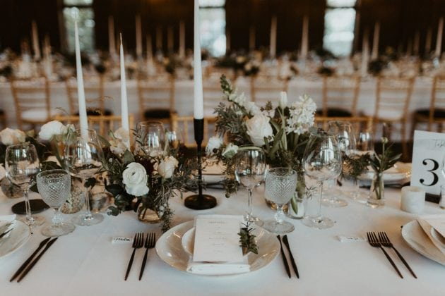 Black and white tablescape at a Castle Winter Wedding by wedding planners and event stylists, Knot & Pop. Photography by The Hendrys.