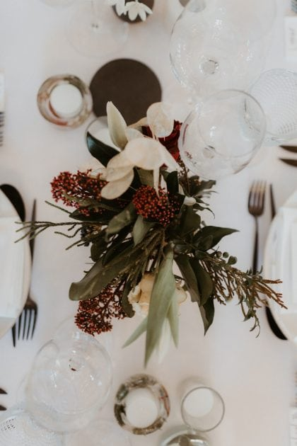 Winter flowers with deep red at a Castle Wedding by wedding planners and event stylists, Knot & Pop. Photography by The Hendrys.