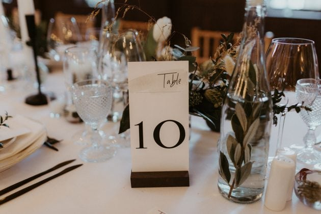 Black and White table numbers at a Castle Winter Wedding by wedding planners and event stylists, Knot & Pop. Photography by The Hendrys.