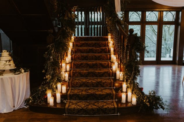 Candle staircase at a Castle Winter Wedding by wedding planners and event stylists, Knot & Pop. Photography by The Hendrys.