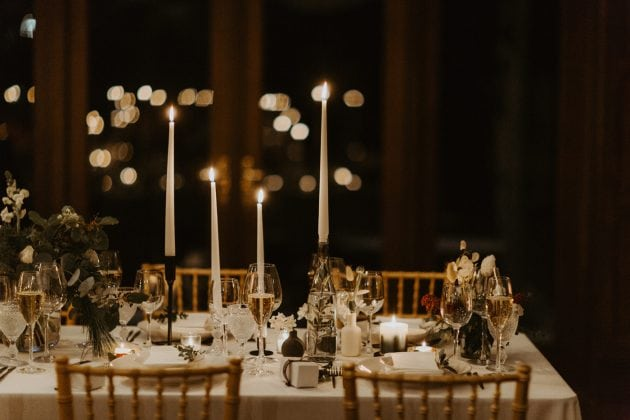 Candlelight dinner at a Castle Winter Wedding by wedding planners and event stylists, Knot & Pop. Photography by The Hendrys.
