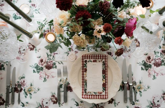 A luxurious wedding in the English Countryside featuring gingham and Autumnal leaves. Event design by Knot & Pop. Photography Taylor & Porter